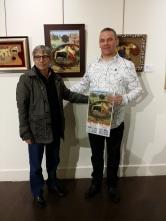 Con el pintor Marcial Ortiz, quien me regaló un cartel de las corridas de septiembre de 2011, Barcelona.